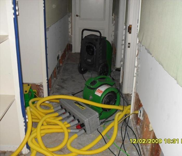 hallway with green and yellow drying equipment