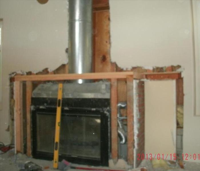 fireplace with sheetrock cut out and framing in place