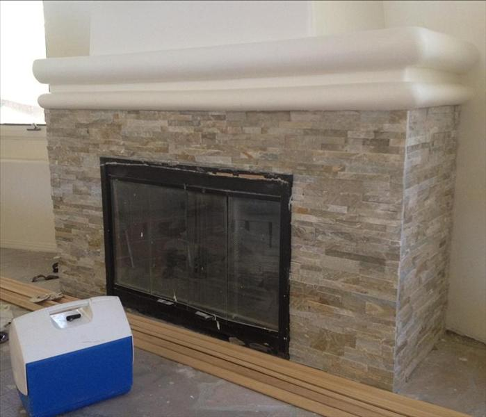 fireplace redone with stone and mantle